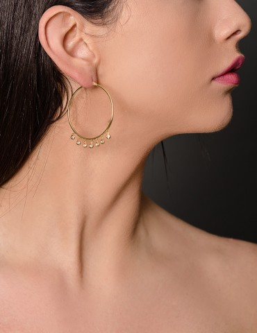 Gold hoop earrings with...