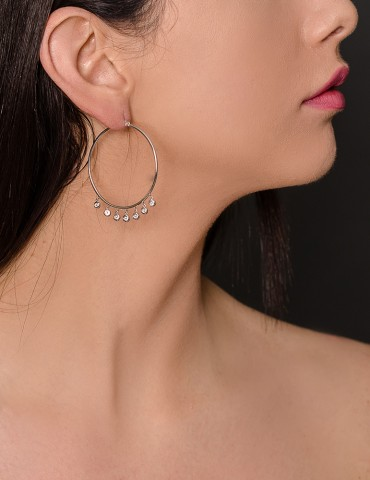 Silver hoop earrings with white zircon drops