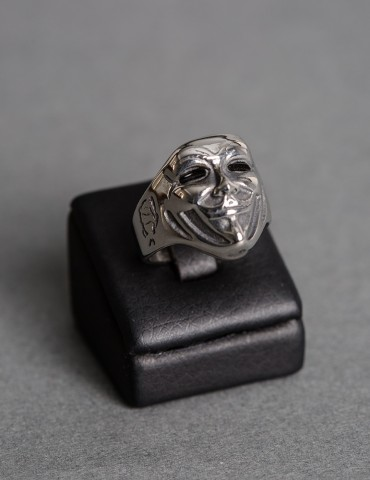 Silver ring with figure
