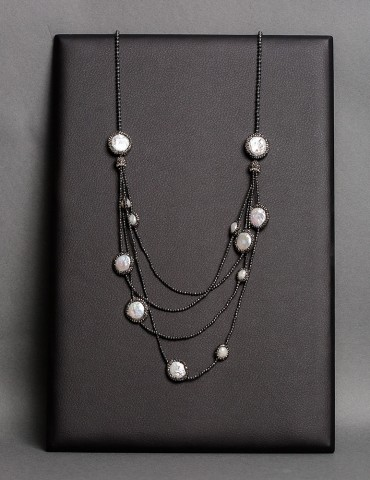 Layering long black necklace with natural pearls