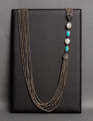 Layering long beige necklace with turquoise stone